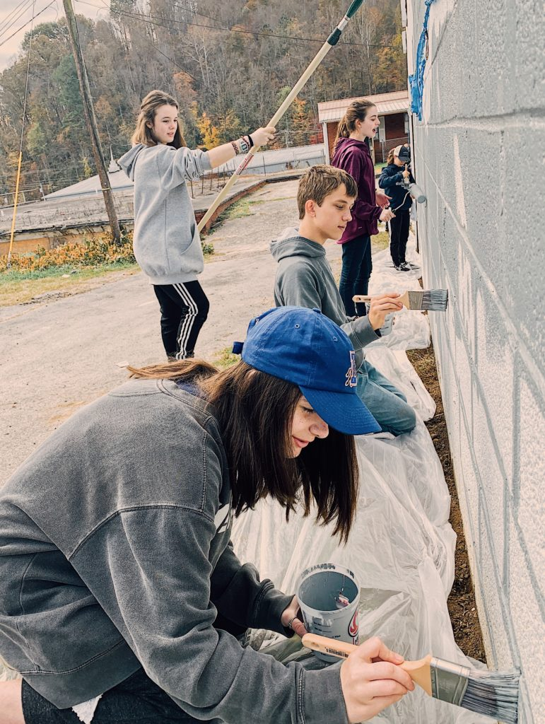 Junior High students mission trip painting